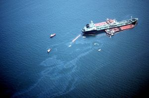 An aerial image of an oil sheen near a vessel.