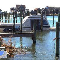 Sinking boat near a dock.