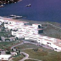 Building complex along a lakefront.