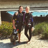 Two people in scuba diving gear posing for a photo.