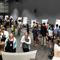 People milling around at a poster session.