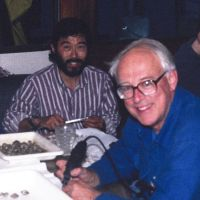 Two men sitting at a table.