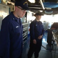 Two officers on the deck of a ship