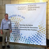 Man standing in front of National Academies of Sciences banner.