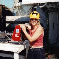 Woman posing on a research vessel.