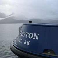 Boat stern with mountains in background.