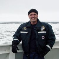 Photo of a man in uniform on a boat.