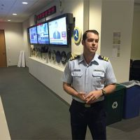 Man in uniform standing in hall.