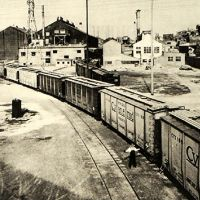 Old photo of train with American Cyanamid written on side of boxcar.