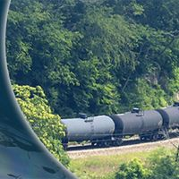 Part of the program with photo of train tank cars.