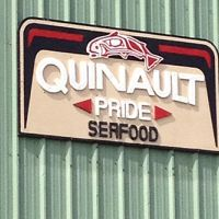 Outdoor sign advertising Quinault seafood.