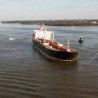 Ship listing in the river. (NOAA)