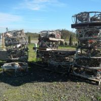 Recovered crab pots stacked on the ground.