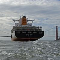 Cargo ship in San Francisco Bay with Bay Bridge.