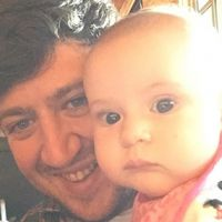 Jack Marshall holding his baby niece, Magnolia.
