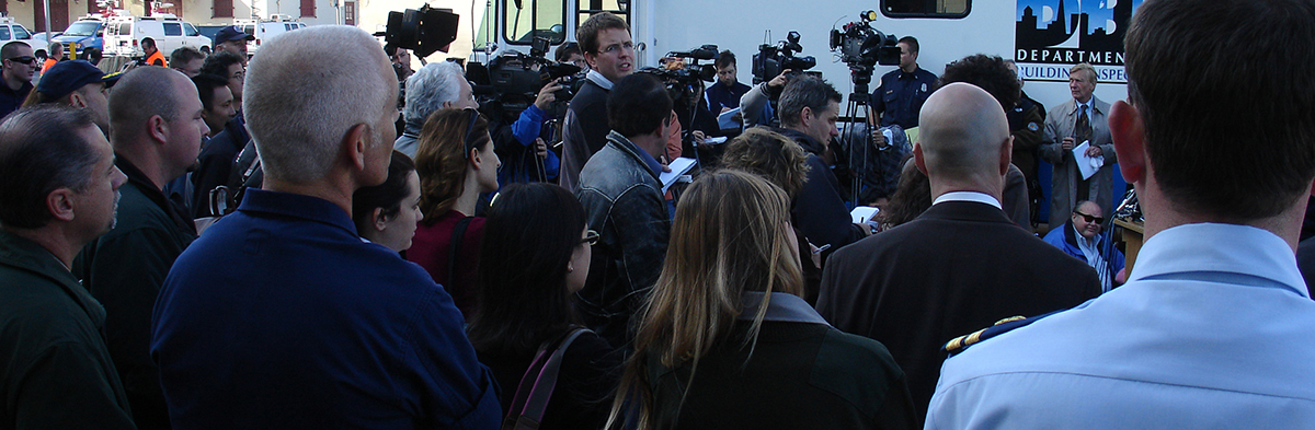 A group of people at a press conference.