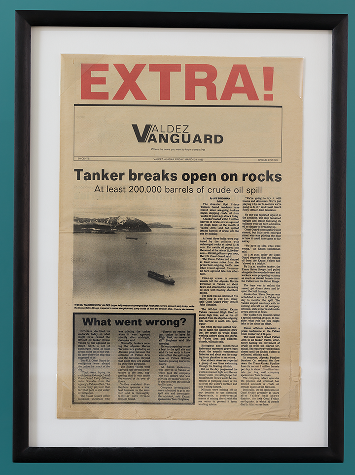 A framed copy of the front page of the local newspaper in Valdez, Alaska, first reporting on the Exxon Valdez's grounding and oil spill on March 24, 1989.